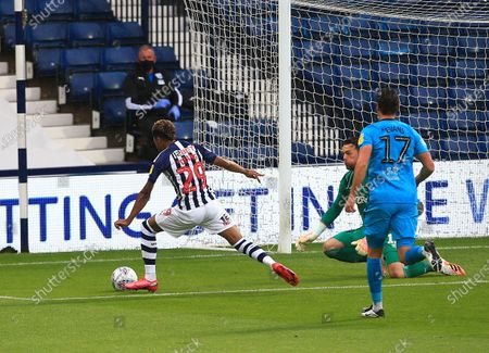 Grady Diangana of West Bromwich Albion goes around Derby County goakeeper Ben Hamer to score the opening goal of the game