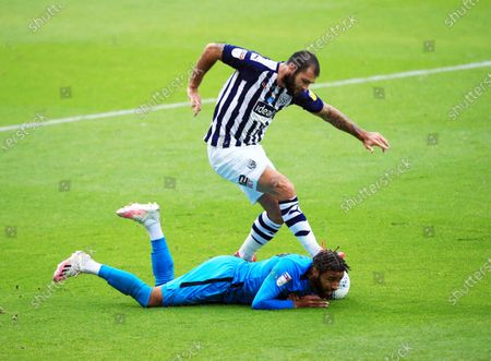 Charlie Austin of West Bromwich Albion and Jayden Bogle of Derby County