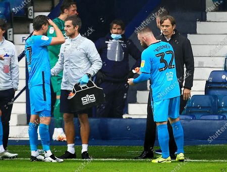 Derby County manager Phillip Cocu issues instructions to Wayne Rooney