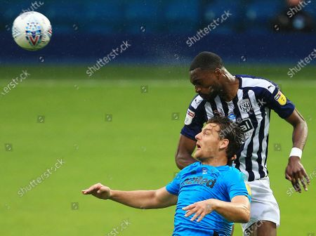 Chris Martin of Derby County and Semi Ajayi of West Bromwich Albion