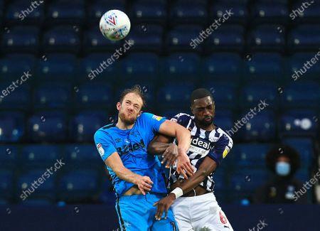 Matthew Clarke of Derby County and Semi Ajayi of West Bromwich Albion