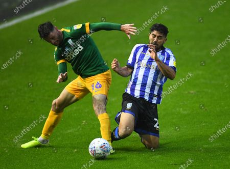 Andrew Hughes of Preston North End and Massimo Luongo of Sheffield Wednesday