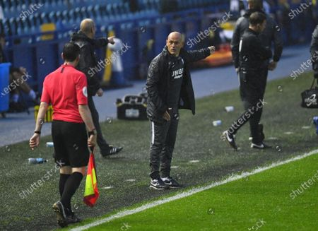 Alex Neil manager of Preston North End has a discussion with the linesman