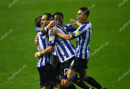 Julian Borner of Sheffield Wednesday celebrates with teammates only to see his goal ruled out for a foul on Declan Rudd goalkeeper of Preston North End