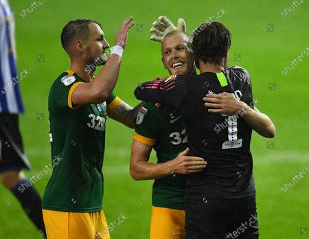 Jayden Stockley of Preston North End (centre) celebrates with Patrick Bauer and Declan Rudd at full time