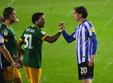 Scott Sinclair of Preston North End and Adam Reach of Sheffield Wednesday bump wrists at full time