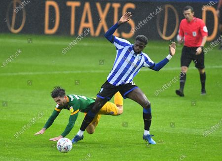 Sean Maguire of Preston North End is fouled by Dominic Iorfa of Sheffield Wednesday