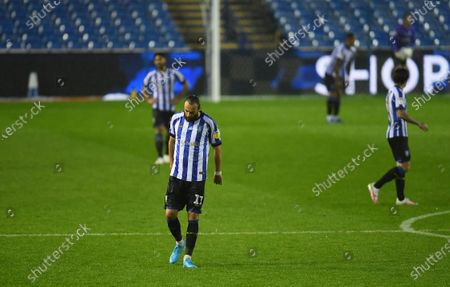 Atdhe Nuhiu of Sheffield Wednesday and his teammates are dejected after conceding a second goal