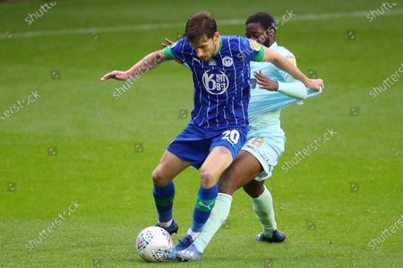 Aramide Oteh of QPR and Joe Williams of Wigan Athletic