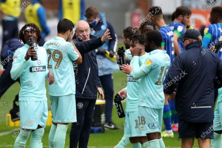 QPR manager Mark Warburton gives instructions during the drinks break