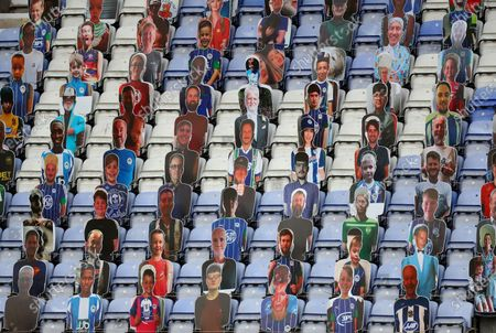 Cardboard cutouts of fans at the DW stadium