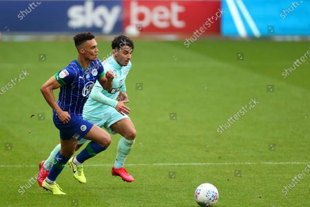 Ilias Chair of QPR and Antonee Robinson of Wigan Athletic