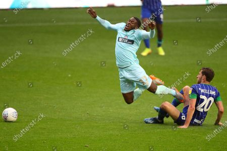 ******caption correction***** Olamide Shodipo of QPR and Joe Williams of Wigan Athletic
