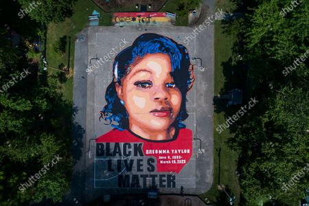 An image made with a drone shows a mural of Breonna Taylor, who was killed in her own apartment by Louisville, Kentucky police officers, on two basketball courts in Annapolis, Maryland, USA, 08 July 2020. Taylor was shot at least eight times on 13 March as police, executing a so-called no-knock warrant, forcibly entered her apartment on a narcotics raid. No drugs were found.