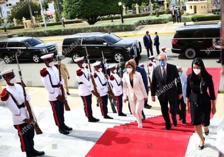 President-elect Luis Abinader (C), accompanied by his vice-president Raquel Pena (L), receive honors upon entering the National Palace to hold a meeting with President Danilo Medina (out of frame), in Santo Domingo, Dominican Republic, 08 July 2020.The President-elect of the Dominican Republic, Luis Abinader, visited this Wednesday current president, Danilo Medina, in the National Palace to start the transfer of power, which will be effective on 16 August.
