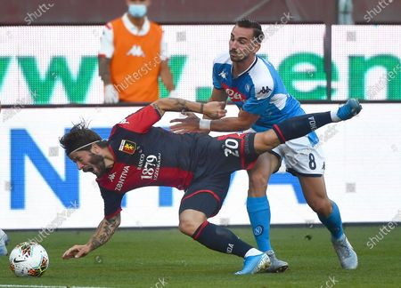 Genoa's Lasse Schone (L) in action against Napoli's Fabian Ruiz (R) during the Italian Serie A soccer match between Genoa CFC and SSC Napoli at Luigi Ferraris stadium in Genoa, Italy, Genoa, 08 July 2020.
