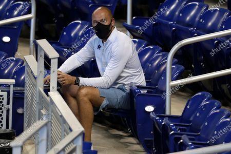Miami Marlins CEO Derek Jeter watches baseball practice at Marlins Park, in Miami