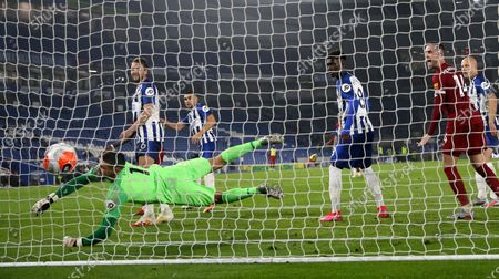 Brighton's goalkeeper Mathew Ryan fails to stop a goal from Liverpool's Mohamed Salah, not pictured, during the English Premier League soccer match between Brighton and Liverpool at Falmer Stadium in Brighton, England
