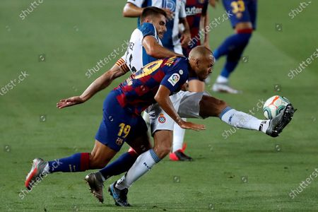 Stock Image of FC Barcelona's Martin Braithwaite (R) in action against Espanyol's David Lopez (L) during the Spanish LaLiga soccer match between FC Barcelona and RCD Espanyol at Camp Nou stadium in Barcelona, north-eastern Spain, 08 July 2020.