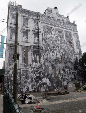 A giant photographic mural entitled 'The Chronicles of New York City' by French artist JR was placed onto the side of 80 Hanson Place.