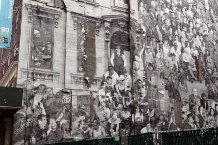 Stock Photo of A giant photographic mural entitled 'The Chronicles of New York City' by French artist JR was placed onto the side of 80 Hanson Place.