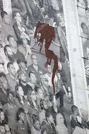 Stock Picture of A giant photographic mural entitled 'The Chronicles of New York City' by French artist JR was placed onto the side of 80 Hanson Place.