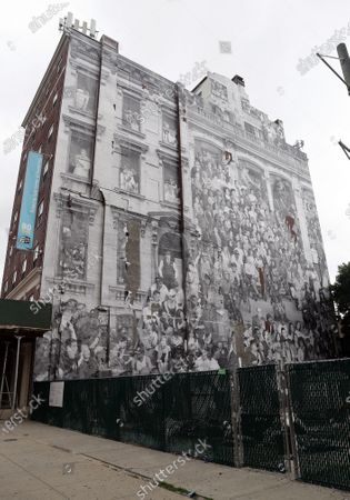 Stock Image of A giant photographic mural entitled 'The Chronicles of New York City' by French artist JR was placed onto the side of 80 Hanson Place.