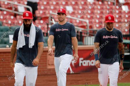 St. Louis Cardinals' Paul Goldschmidt, center, walks with teammates Matt Carpenter, left, and Yadier Molina during baseball practice at Busch Stadium, in St. Louis