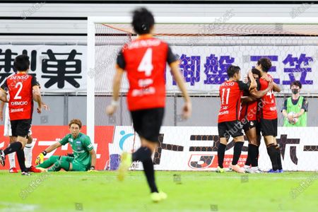 (L-R)  Masaaki Higashiguchi (Gamba),  Nagoya Grampus team group (Grampus) - Football / Soccer :  2020 J1 League match between Nagoya Grampus 2-2 Gamba Osaka at Toyota Stadium in Toyota, Aichi, Japan.