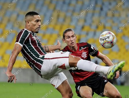 Gilberto (L) of Fluminense in action against Filipe Luis (R) of Flamengo during the Carioca Tournament final soccer match between Fluminense and Flamengo at Maracana Stadium in Rio de Janeiro, Brazil, 08 July 2020. The match was played without spectators due to the coronavirus pandemic.
