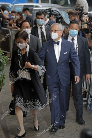 Stock Photo of Former Hong Kong Chief Executive Donald Tsang, right, and his wife Selina attend the late Macao tycoon Stanley Ho's funeral memorial in Hong Kong, . Stanley Ho, the dashing billionaire and bon vivant who was considered the father of modern gambling in China, who died last May