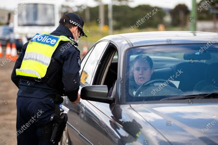 A woman is fined $1652 for breaking stage 3 restrictions as she passed through a roadblock south of Gisborne as Melbourne plunges back into Stage 3 lockdowns during COVID 19. After a sustained outbreak across Melbourne, Stage 3 lockdowns re-commence across the city today along with one regional shire, Mitchell. Residents can only leave their home for four reasons from midnight last night. Police are setting up roadblocks across Melbourne to stop anyone flouting the rules and will check an unprecedented number of drivers as well as door knock the effected areas. Stats across Australia are now completely closing their borders to Victorians. This comes after 118 new coronavirus cases being discovered Tuesday night bringing the total cases in Victoria to 860.