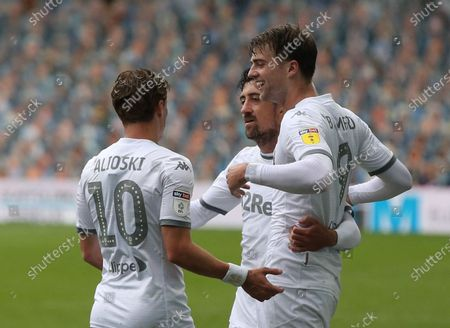 Patrick Bamford celebrates scoring Leeds 5th Goal with Hernandez and Alioski