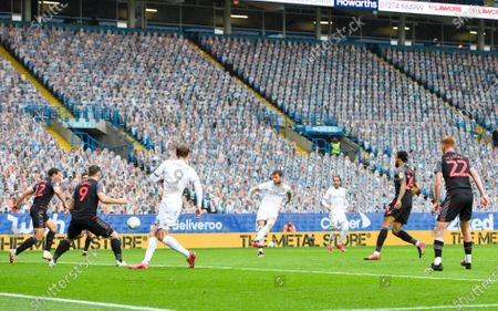 Liam Cooper of Leeds United scores the third goal 3-0