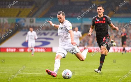Jack Harrison of Leeds United shoots at goal as Danny Batth of Stoke City looks on