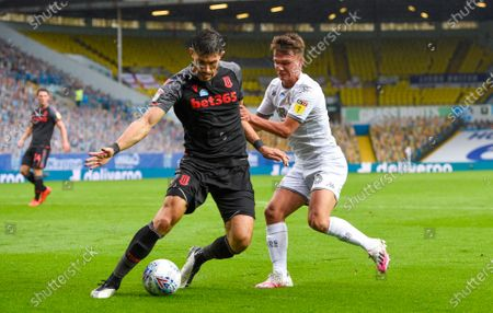 Jamie Shackleton of Leeds United tackles Danny Batth of Stoke City