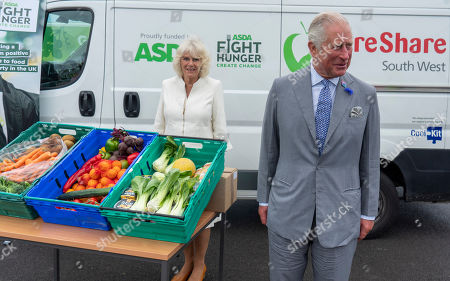 Photo libre de droits de Prince Charles, President of Business in the Community, and Camilla Duchess of Cornwall visited an Asda Distribution Centre to thank staff who have kept the countrys vital food supplies moving throughout the coronavirus pandemic.
