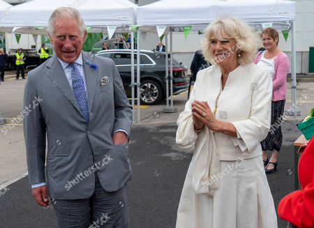Illustration libre de droits de Prince Charles, President of Business in the Community, and Camilla Duchess of Cornwall visited an Asda Distribution Centre to thank staff who have kept the countrys vital food supplies moving throughout the coronavirus pandemic.