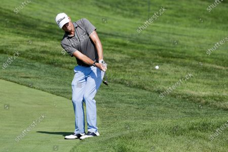 Nick Watney hits during opening round of the Workday Charity Open golf tournament, in Dublin, Ohio