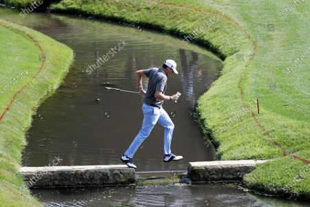 Nick Watney crosses a bridge to the 14th hole during opening round of the Workday Charity Open golf tournament, in Dublin, Ohio