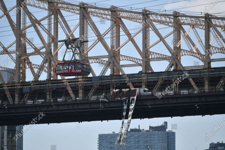 Stock Image of A banner protesting police brutality hangs from the Queensboro Bridge in New York.