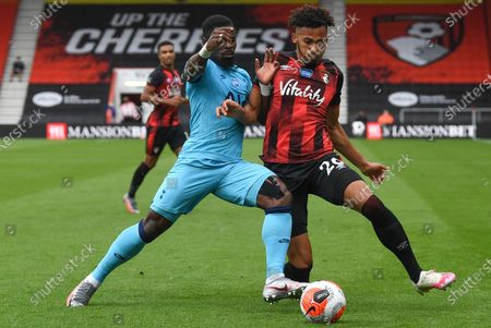 Lloyd Kelly (R) of Bournemouth in action against Serge Aurier (L) of Tottenham during the English Premier League match between AFC Bournemouth and Tottenham Hotspur in Bournemouth, Britain, 09 July 2020.