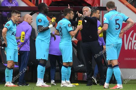 Tottenham Hotspur manager Jose Mourinho (2-R) speaks to his players in a drinking break during the English Premier League match between AFC Bournemouth and Tottenham Hotspur in Bournemouth, Britain, 09 July 2020.