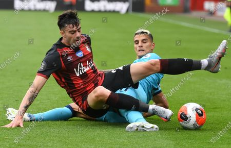 Diego Rico (L) of Bournemouth in action against Erik Lamela (R) of Tottenham during the English Premier League match between AFC Bournemouth and Tottenham Hotspur in Bournemouth, Britain, 09 July 2020.