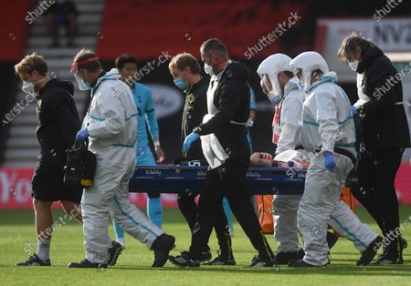 Adam Smith of Bournemouth is carried off for treatment during the English Premier League match between AFC Bournemouth and Tottenham Hotspur in Bournemouth, Britain, 09 July 2020.