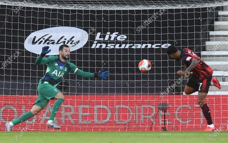 Joshua King (R) of Bournemouth in action against goalkeeper Hugo Lloris (L) of Tottenham  during the English Premier League match between AFC Bournemouth and Tottenham Hotspur in Bournemouth, Britain, 09 July 2020.