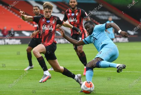 David Brooks (L) of Bournemouth in action against Tanguy Ndombele (R) of Tottenham during the English Premier League match between AFC Bournemouth and Tottenham Hotspur in Bournemouth, Britain, 09 July 2020.