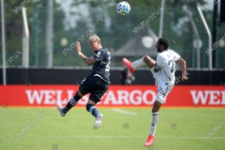 New York City FC's Ronald Matarrita (22) and Philadelphia Union's Raymon Gaddis (28) battle for a ball during an MLS soccer match, in Kissimmee, Fla