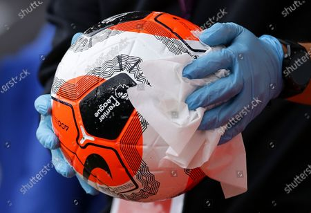 An official sanitizes the ball during the English Premier League match between AFC Bournemouth and Tottenham Hotspur in Bournemouth, Britain, 09 July 2020.