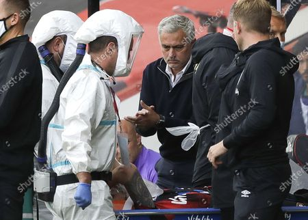 Tottenham Hotspur manager Jose Mourinho (C-R) reacts as Bournemouth's Adam Smith (C-L) is stretchered off after sustaining an injury during the English Premier League match between AFC Bournemouth and Tottenham Hotspur in Bournemouth, Britain, 09 July 2020.